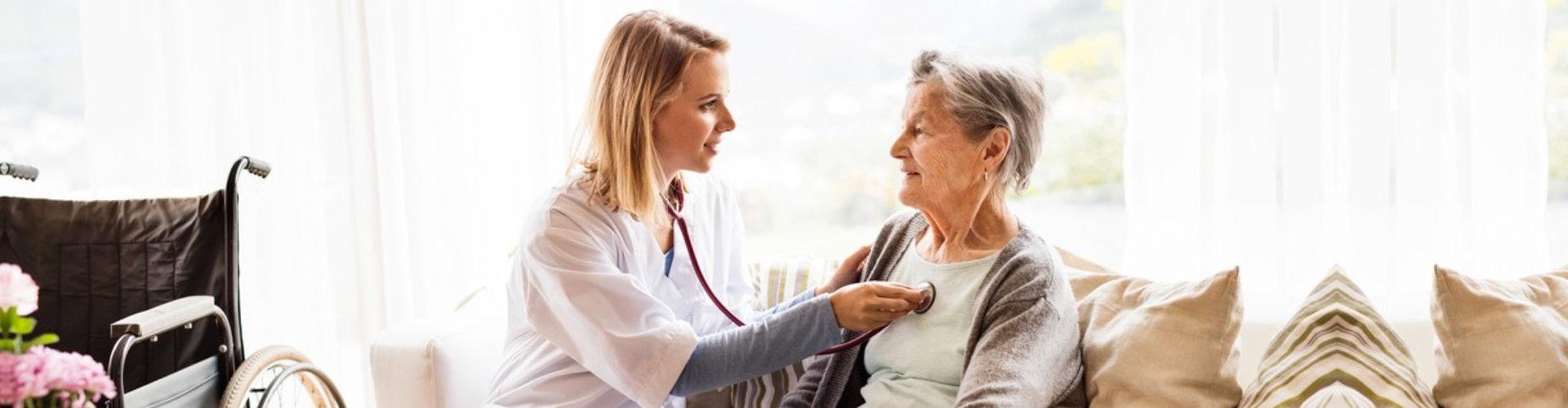 a woman checking heartbeat of an elderly woman