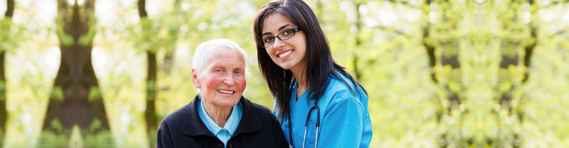 a gorgeous caregiver and an elderly woman